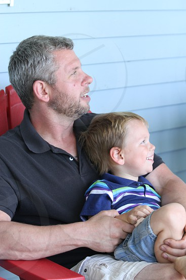 Daddy's laps make the best seats. photo