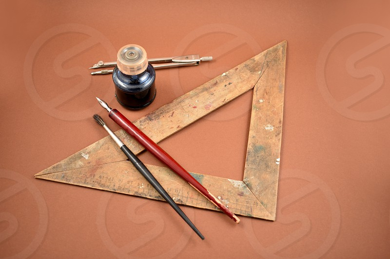 Old art tools. Old tools for drawing. Vintage painting tools on a brown background. Art supplies images photo
