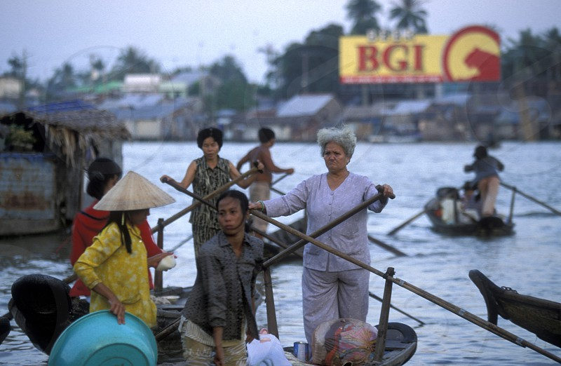 People at the Flooting Market on the Mekong River near the city of Can Tho in the Mekong Delta in Vietnam photo