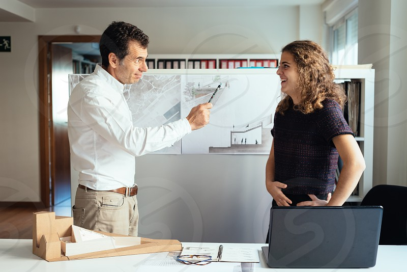 Two architects working with blueprints in a project photo