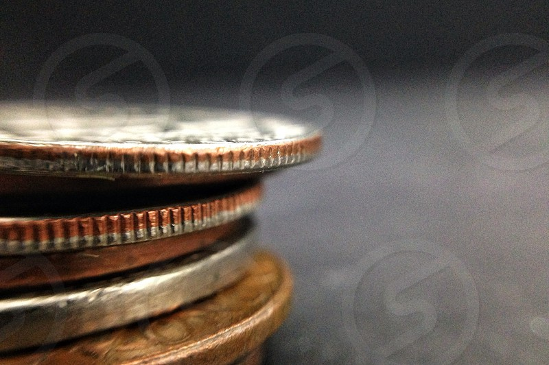 gold and copper coin photo