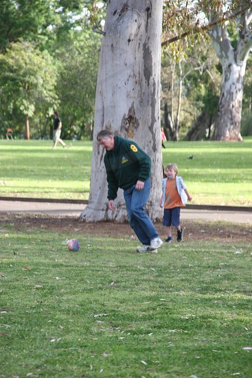 Adult and child playing football photo
