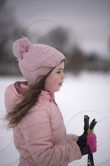 portrait of a  young girl skiing  with the wind blowing in her hair  photo