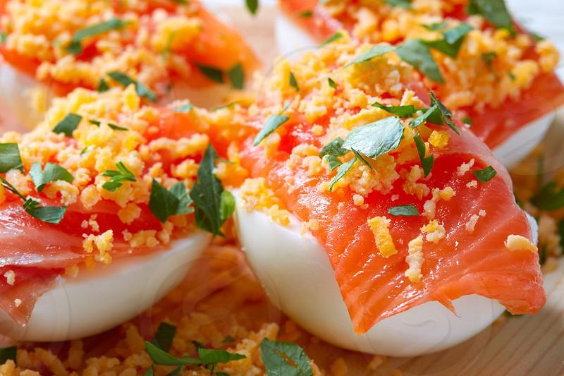 Filled eggs with salmon pinchos tapas from Spain recipes pintxos photo