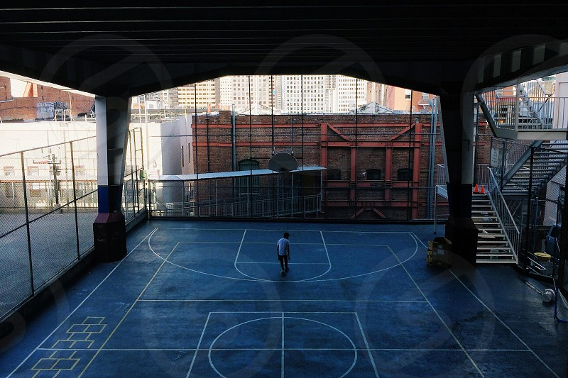 man in outdoor basketball covered court photo