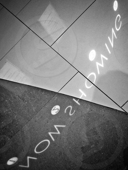 "Reflection on the cinema's floor.. ""Now Showing"". photo"