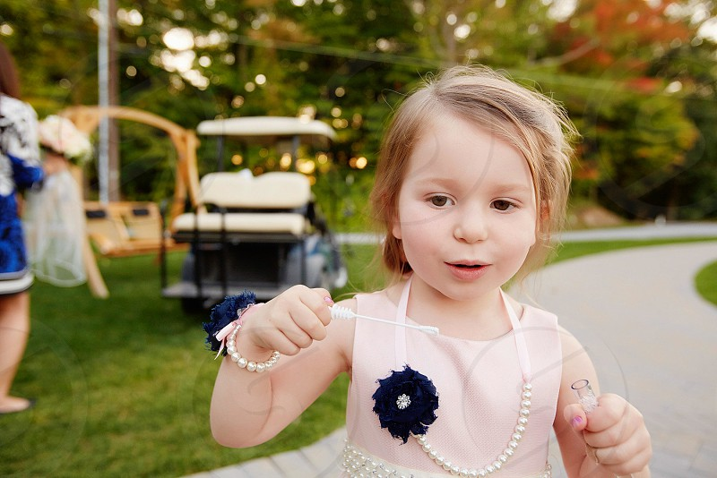 Flower girl wedding little girl bubbles blowing bubbles sweet girl pretty in pink precious adorable photo
