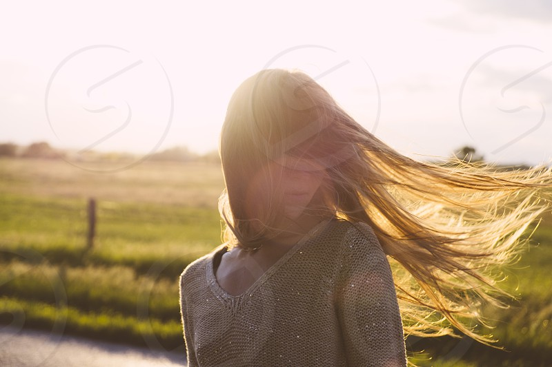 Windy weather and a woman with long hair photo