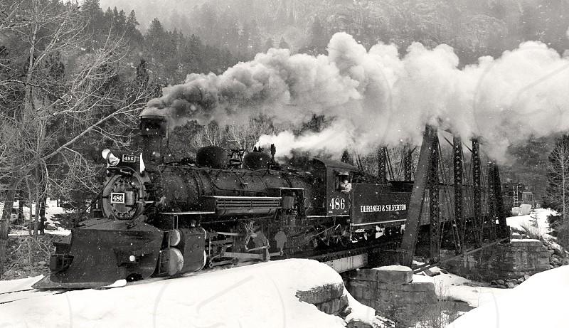 Durango & Silverton's #486 'K-28' Steam Locomotive as it crosses Tefft bridge in the always majestic San Joaquin Mountains of Colorado.  photo