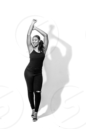 Model smiling in studio with shadow photo