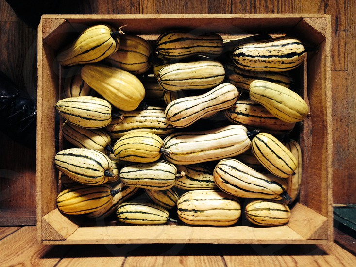 yellow squash in brown wooden box crate photo