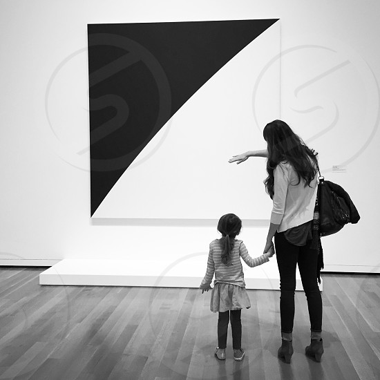 woman holding child's hand at the gallery photo