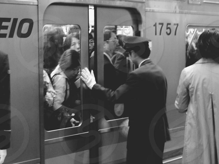 man in black suit closing door photo