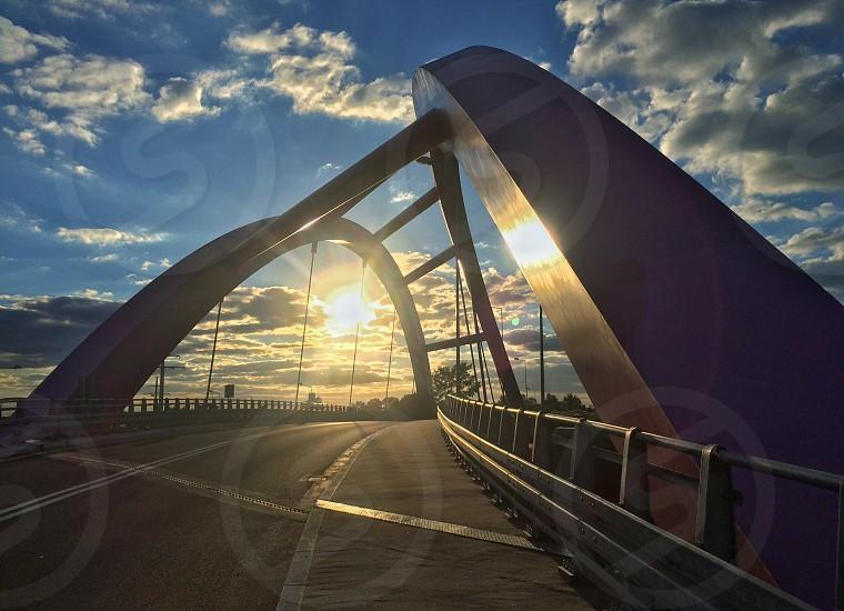 Skewed bridge sunlight clouds sky sunset sunrise photo