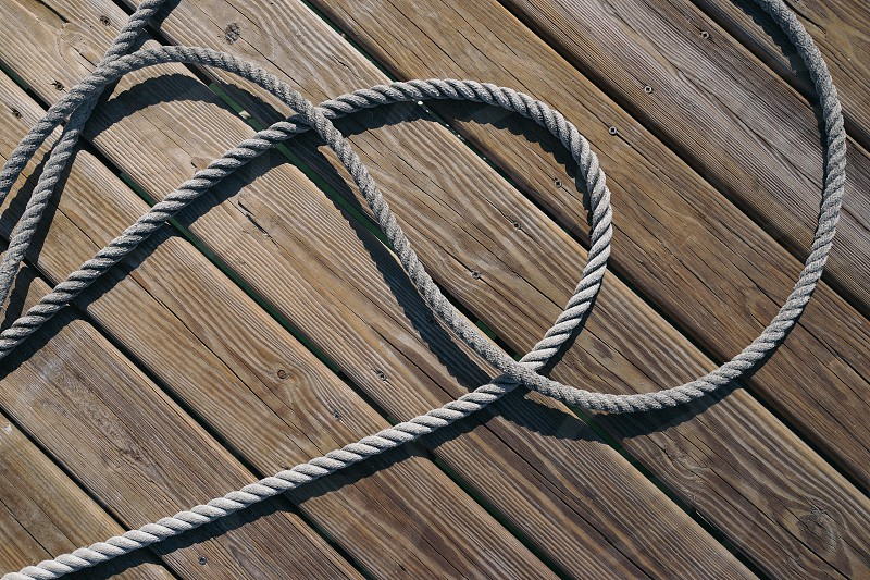 Boating. Sailing. Yachting. Dock. Rope. Wood.  photo