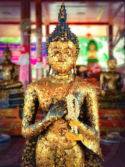 Buddha image statue Buddhist Buddhism temple gold golden religion row arrayed sacred pray worship homage sculpture art ancient antique artifact Thailand bangkok southeast Asia photo
