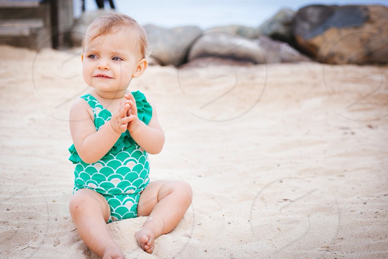 baby's green and beige 1 piece swim suit photo