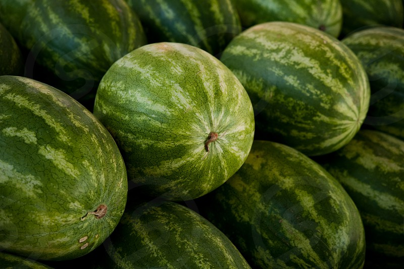 A stack of watermelons for sale at market photo