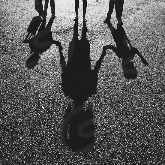 3 people shadow photo