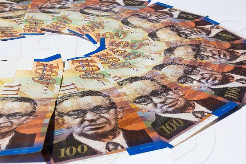 Stack of Israeli money bills of 100 shekel. photo