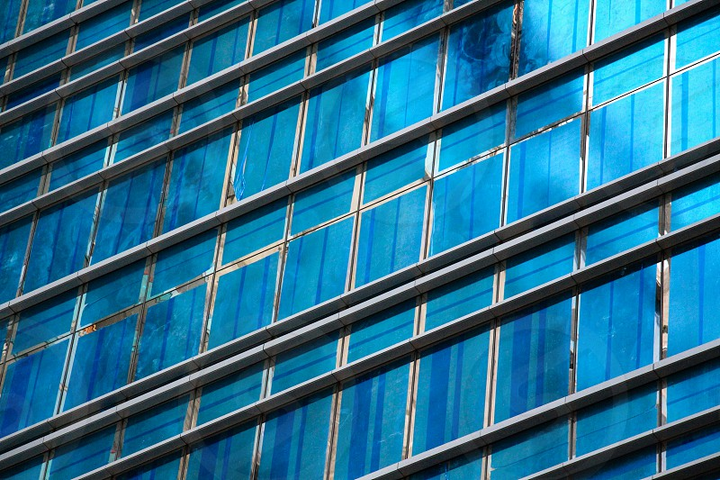 glass windows of building with reflection of light during daytime photo