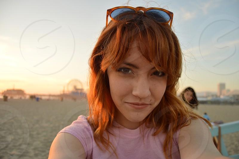 woman taking selfie during sunset photo