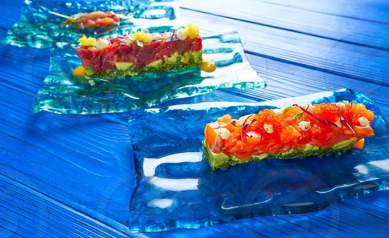 Salmon and Tuna Tartare with Anchovies tomato starter Tartar tapas photo