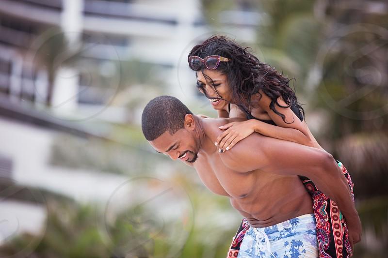 Newlyweds on Honeymoon beautiful African American couple  photo
