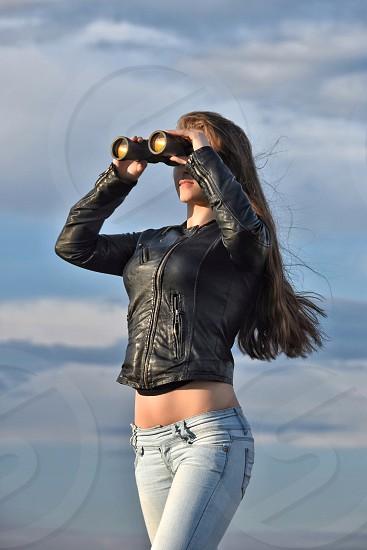 Looking in to binoculars  photo
