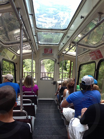 people sitting inside train going down the railway photo
