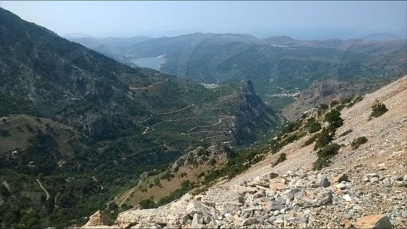 Mountains and valley in Crete with reservoir in distance photo