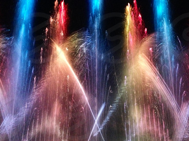 blue red and white lighted water fountain photo