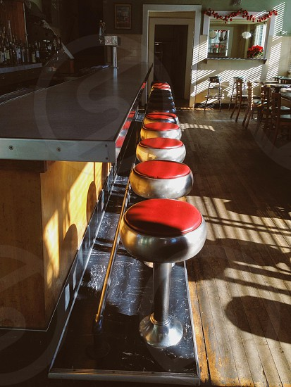 red and silver bar chairs photo
