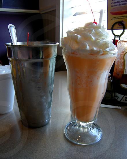 Orange cream milkshake glass and shaker photo