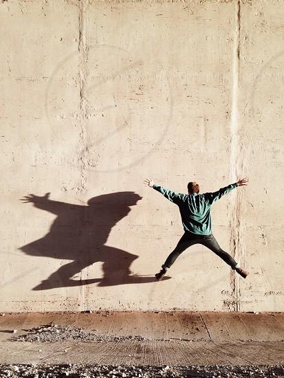 man caught in jump shot photo