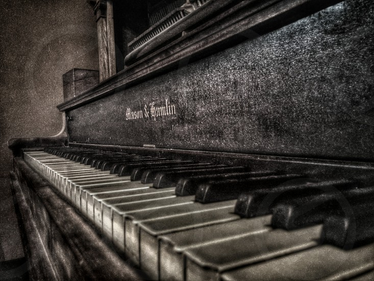 grayscale photography of spinet piano photo