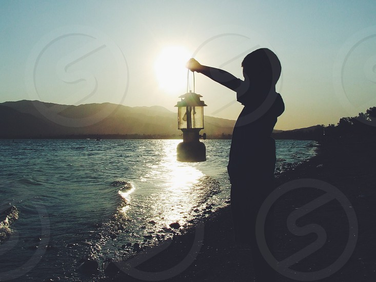 boy holding lantern photo