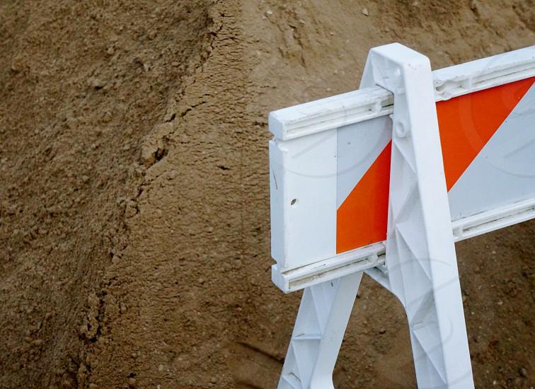 white and orange construction warning photo