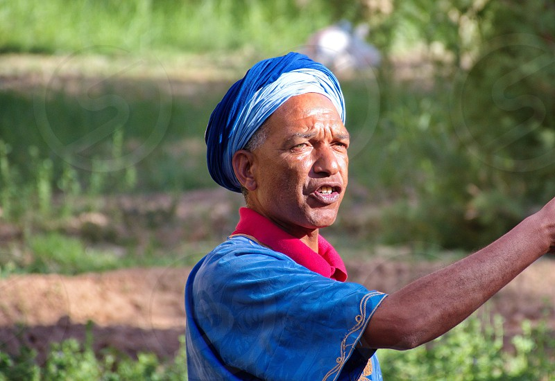 Portrait of Berber in oasis in Morocco photo