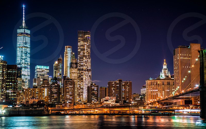 View of Manhattan business district from Brookly Bridge Park photo