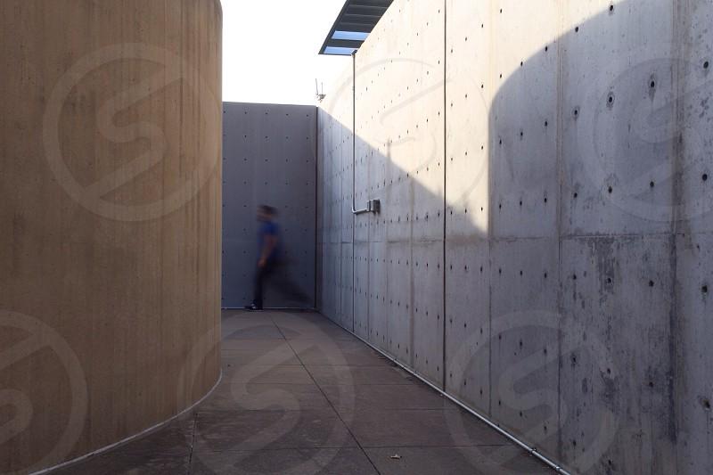 man in blue shirt walking photo