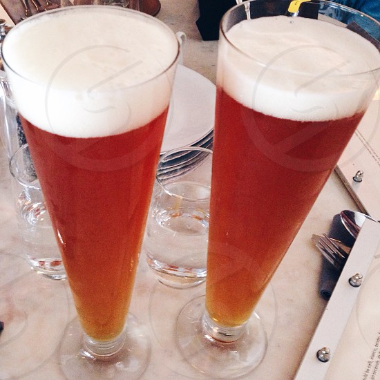Two tall glasses of craft beer photo