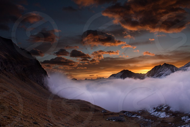 Great view of the foggy valley in Gran Paradiso National Park  Alps Italy  dramatic scene beautiful world. colourful autumn morningscenic view with cloudy sky majestic dawn in mountain landscape photo