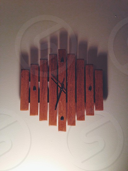 brown slatted wall hanging clock photo