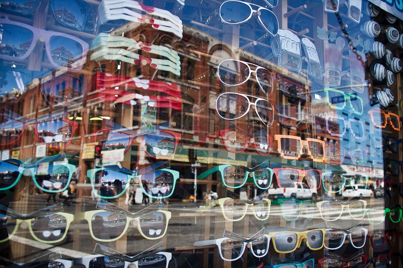 assorted sunglasses behind store window photo