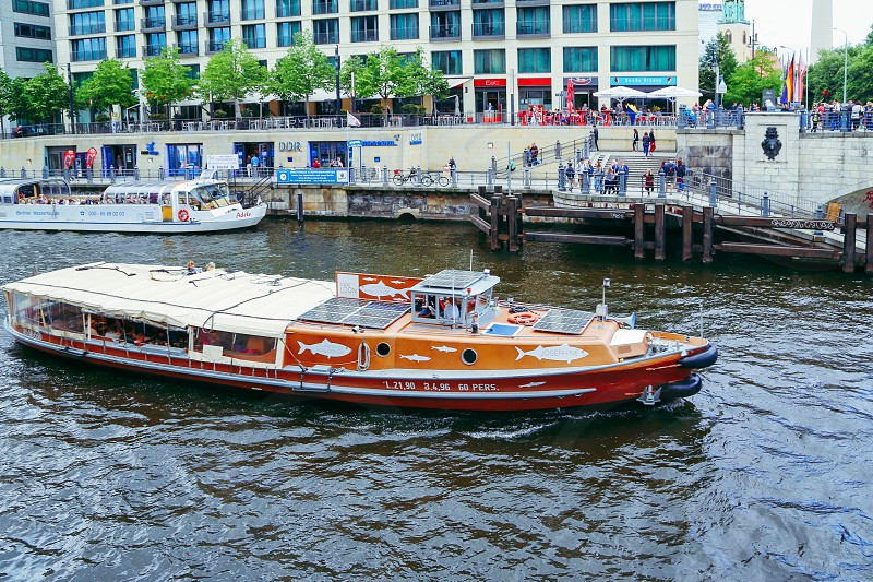 Boating lifestyle  boat river city people  sightseeing Berlin  photo