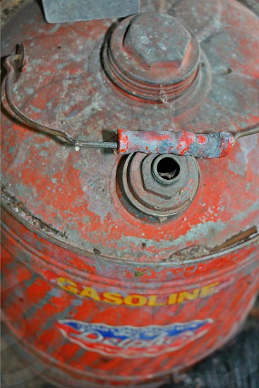 gas can vintage red gas can handle gasoline photo