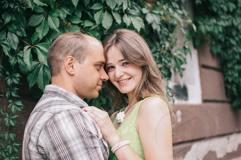 Loving couple is hugging each other and girl is looking into camera photo