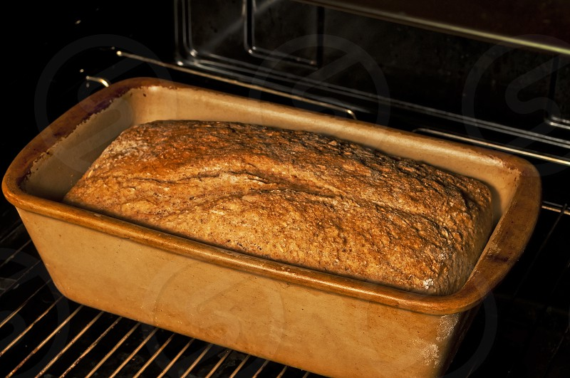 whole grain bread in an oven photo
