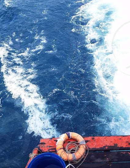 orange life saver ring boat  photo